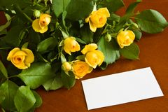 Yellow roses with blank note Stock Photo