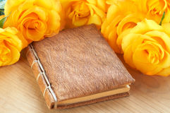 Yellow roses on a book Royalty Free Stock Photography