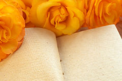 Yellow roses on a book Stock Photo