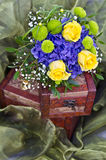 Yellow roses bouquet on box Royalty Free Stock Image