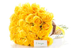Yellow roses. Bouquet of yellow roses with a declaration of love on a white background Stock Photo