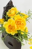 Yellow roses bouquet with rosemary  in a vintage iron as vase Stock Images