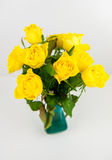 Yellow roses. Bunch of yellow roses in vase on white Stock Image