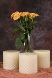 Yellow roses and candles. Bunch of yellow roses and three candles stock photography