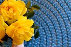 Closeup Yellow Floribunda Roses on Blue mat Royalty Free Stock Photography