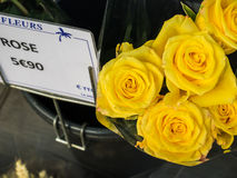 Yellow roses with French price tag in Paris, France Royalty Free Stock Photo