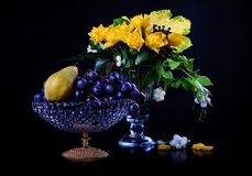 Yellow roses and fruits Stock Images