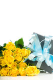 Yellow roses with gift box Royalty Free Stock Images