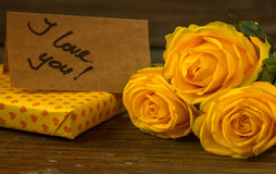 Yellow roses, gift box and card with text I love you Stock Image