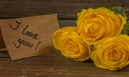 Yellow roses, gift box and card with text I love you Royalty Free Stock Photos