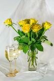 Yellow Roses and glasses of wine Royalty Free Stock Photography