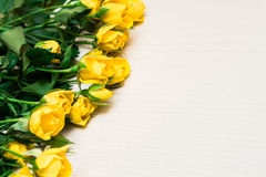 Yellow roses on a light wooden background. Women' s day, Valenti Royalty Free Stock Photo