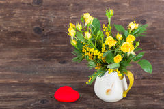 Yellow roses with read heart Royalty Free Stock Photo