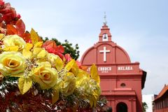 Yellow roses and red church Stock Photo
