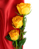 Yellow roses on the red satin Royalty Free Stock Photos