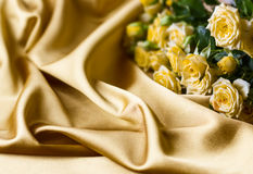 Yellow roses on silk background Royalty Free Stock Image