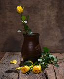 Yellow roses in vase Royalty Free Stock Photo