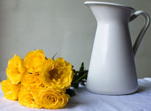 Yellow roses with white jug Royalty Free Stock Image