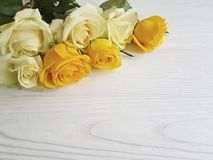 Yellow roses white wooden background decorative  place for text Stock Images