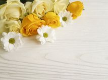 Yellow roses holiday season white wooden background celebration decorative place for text Royalty Free Stock Photo