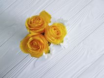 Yellow roses white wooden background place for text. Yellow roses on a white wooden background place for text Stock Photo