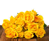 Yellow roses. On a wood old panels Royalty Free Stock Photo