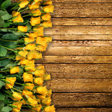 Yellow roses. On the wooden background Stock Images