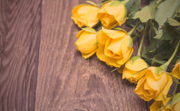 Yellow roses on a wooden background. Women' s day, Valentines Da Royalty Free Stock Photography