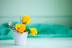 Yellow roses on a wooden table. An autumn background with copy space. Autumn still life. Perfect center Stock Photos
