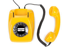 Yellow rotary phone Royalty Free Stock Image