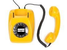 Yellow rotary phone Royalty Free Stock Image
