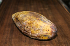 Yellow rotten mango fruit isolated on wooden Royalty Free Stock Images
