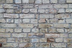 Yellow rough brick wall. As texture or background Stock Image