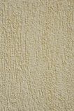 Yellow rough plaster on wall Stock Photo