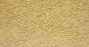 Yellow rough plaster on wall Royalty Free Stock Photos