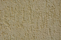 Yellow rough plaster on wall Stock Photography
