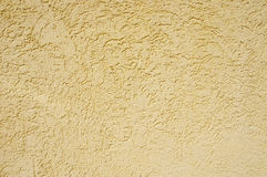 Yellow rough plaster on wall Royalty Free Stock Photo