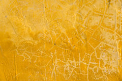 Yellow rough texture cement wall closeup for background Stock Photo