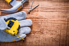 Yellow roulette in protective glove hammer nails Stock Photography