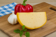 Yellow round cheese Stock Photos