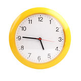 Yellow, round the clock on a white background Royalty Free Stock Images