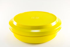 Yellow Round Container. One yellow plastic food container on a white background Stock Image