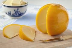Yellow round Edam cheese and slices Stock Photos
