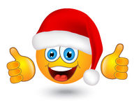Yellow round emotion in Santa hat Royalty Free Stock Photos