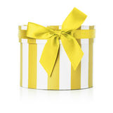 Yellow round gift box isolated on the white background Stock Photography