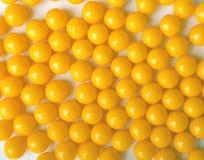 Yellow round pills, as vitamins. Stock Photo
