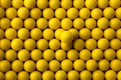 Yellow round pills background Royalty Free Stock Image