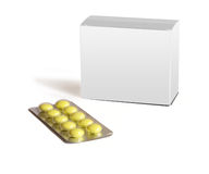 Yellow round pills and grey box-packing are isolat Royalty Free Stock Images