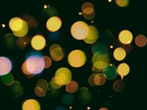 Yellow round soft lights bright glittering celebration or party background on black. Yellow round soft lights bright glittering celebration or party background royalty free stock photos