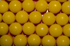 Yellow round vitamins closeup for background Royalty Free Stock Photography